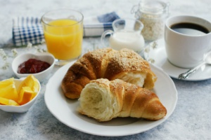 Served breakfast with drinks and croissant